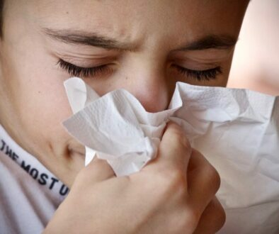 A child having colds and sneezing